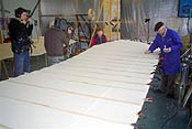 Harald Lohmann inspects the wing fabric covering